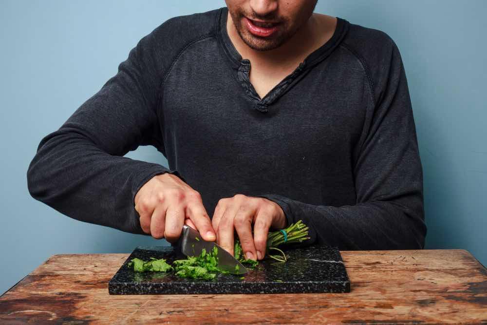 Man chopping herbs Weed Grinder